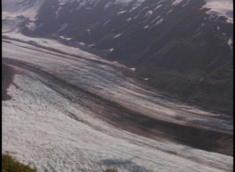 A river flows through an ice covered valley Footage