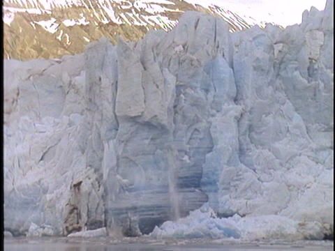 A large chunk of ice falls off a glacier Stock Video Footage