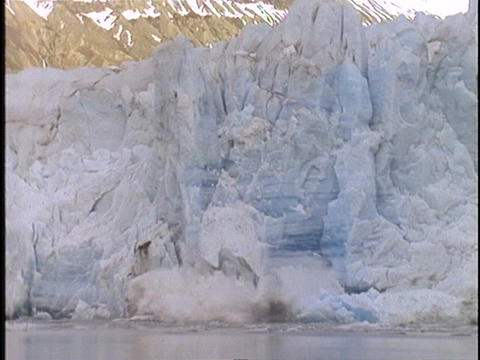 A large chunk of ice falls off a glacier Footage