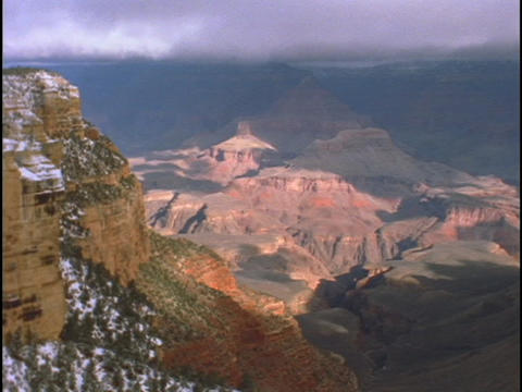 Clouds drift over the Grand Canyon in winter Footage