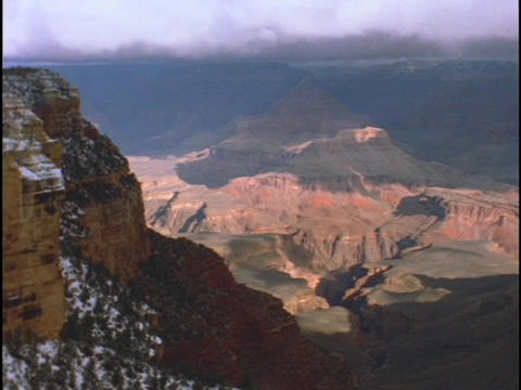 Clouds drift over the Grand Canyon in winter Stock Video Footage