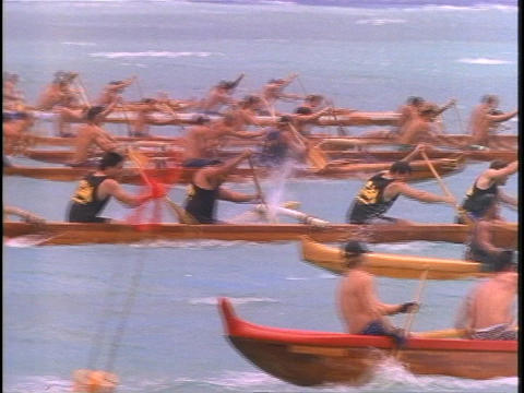 An outrigger canoe race in the South Pacific Stock Video Footage