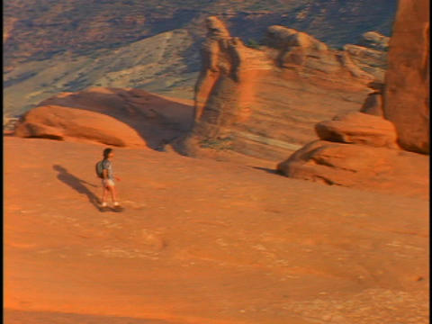 A hiker explores Arches National Park near Moab, Utah Stock Video Footage