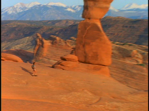 A hiker explores Arches National Park near Moab, Utah Footage