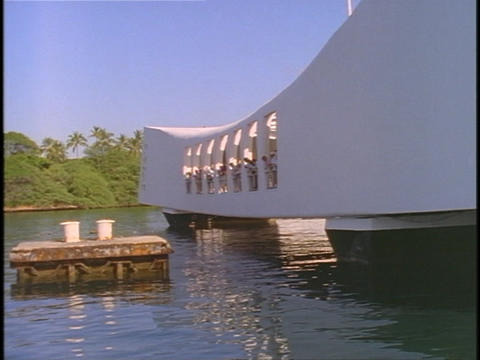 Tourists look into the water at the Pearl Harbor Memorial Stock Video Footage