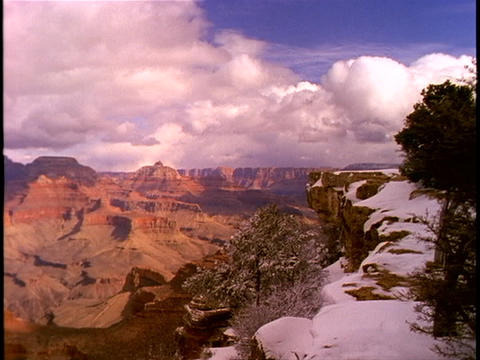 Fresh snow blankets the rim of the Grand Canyon Stock Video Footage
