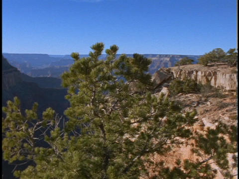 A rocky bluff overlooks the Grand Canyon in Arizona Footage