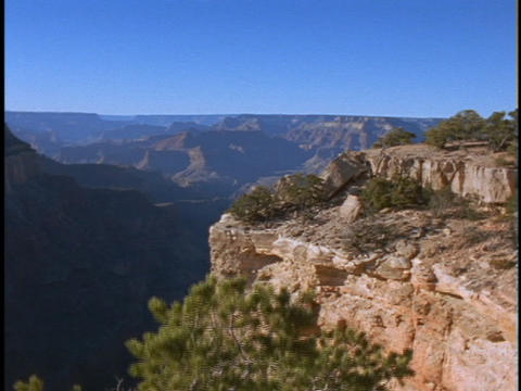 A rocky bluff overlooks the Grand Canyon in Arizona Stock Video Footage
