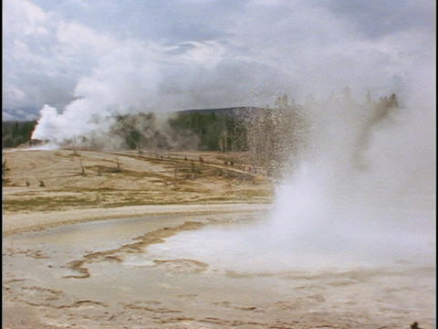 Old Faithful geyser erupts in Yellowstone Park Stock Video Footage