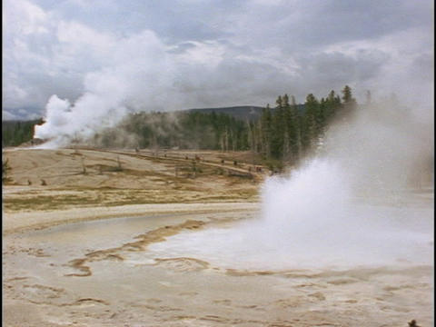 Old Faithful geyser erupts in Yellowstone Park Footage