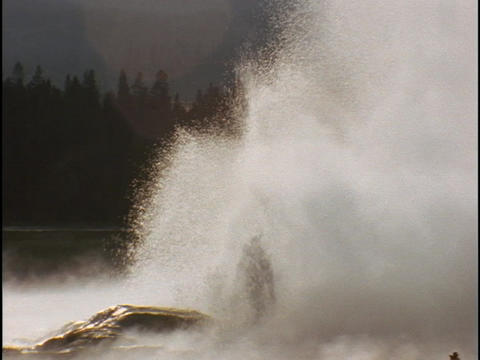 Old Faithful geyser erupts in Yellowstone National Park Footage