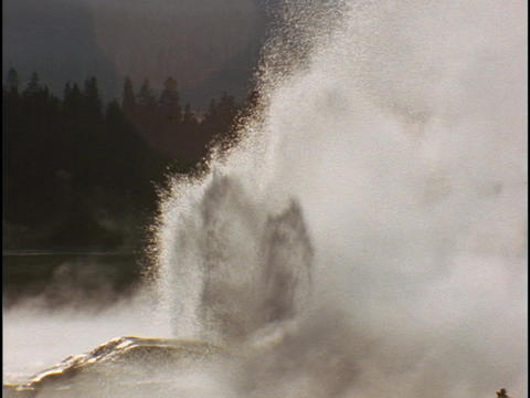 Old Faithful geyser erupts in Yellowstone National Park Stock Video Footage