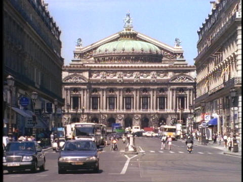 The Opera House in Paris sits at the end of a busy street Stock Video Footage
