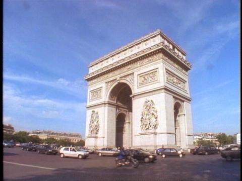 Traffic circles the Arc de Triomphe in Paris Stock Video Footage