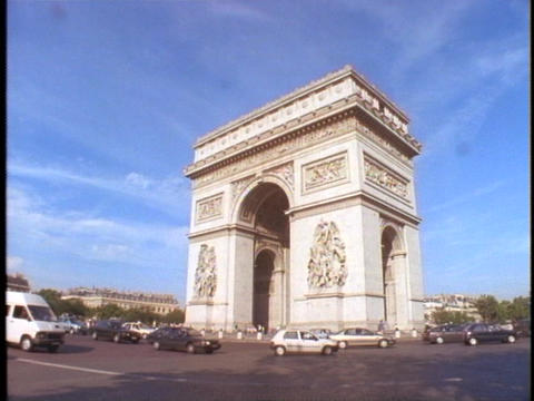 Traffic circles the Arc de Triomphe in Paris Footage