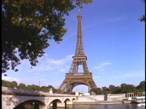 The Eiffel Tower stands high above the city of Paris Footage