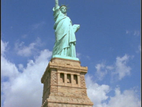 The State of Liberty, in New York City, stands atop a stone tower Footage