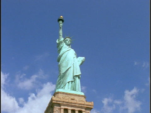 The State of Liberty, in New York City, stands atop a... Stock Video Footage