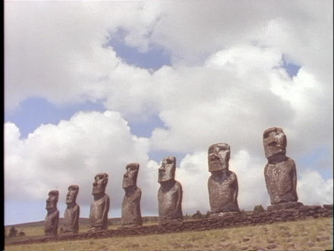 Ancient statues stand in a line on Easter Island Footage