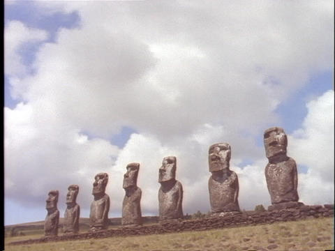Ancient statues stand in a line on Easter Island Stock Video Footage