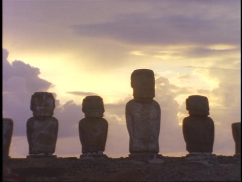 Mysterious Easter Island statues stand like sentinels against a cloudy sky Footage