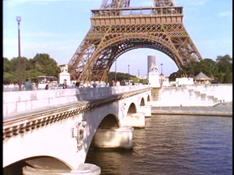 The Eiffel Tower rises high over the Seine river in Paris Stock Video Footage