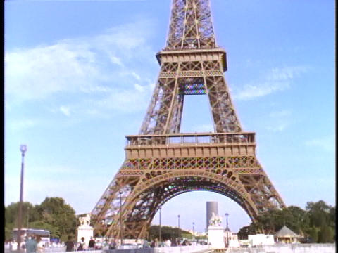 The Eiffel Tower rises high over the Seine river in Paris Footage