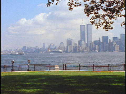 The twin towers of the World Trade Center rise high above New York City Live Action