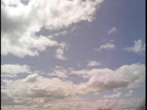 Clouds pass across blue skies Footage