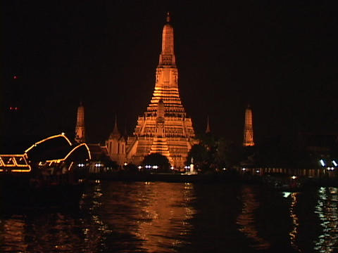 A boat travels along the Chao Phraya River in Thailand Stock Video Footage
