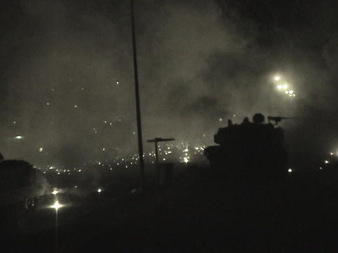 Abrams tanks fire into an Iraqi village Stock Video Footage
