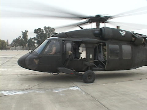 Soldiers use a Black Hawk helicopter for transportation Stock Video Footage