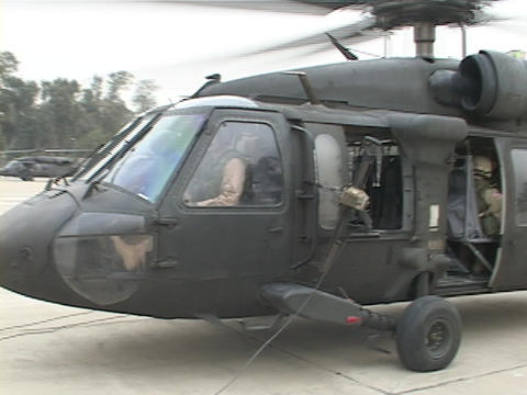 Soldiers use a Black Hawk helicopter for transportation Footage