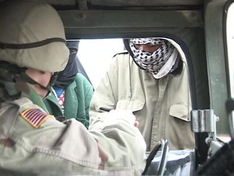 A U.S. soldier gives supplies to Iraqi people Footage