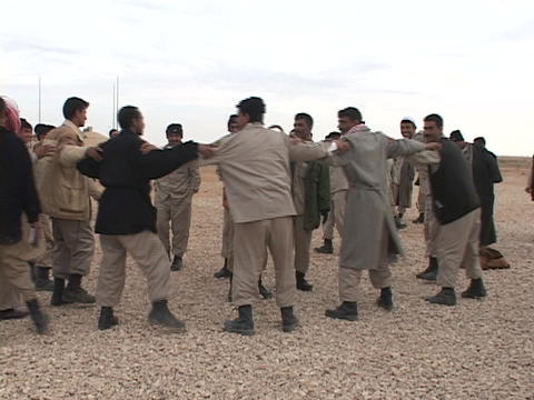 Iraqi troops dance after graduation from a U.S. training... Stock Video Footage