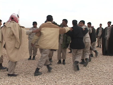 Iraqi troops dance after graduation from a U.S. training academy Footage