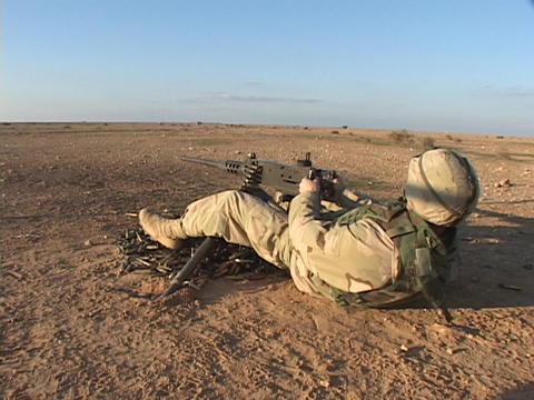 A U.S. soldier fires his weapon during combat Stock Video Footage