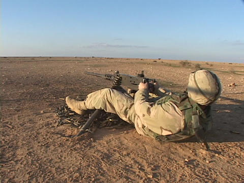 A U.S. soldier fires his weapon during combat Footage