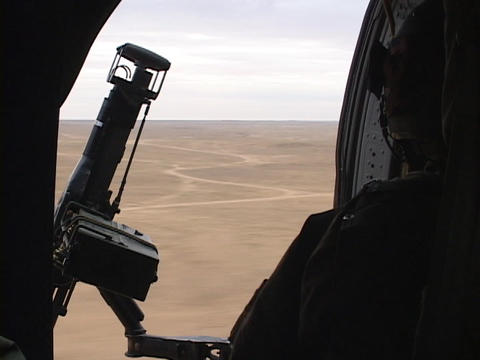 A Black Hawk helicopter carrying soldiers flies over Iraq Footage
