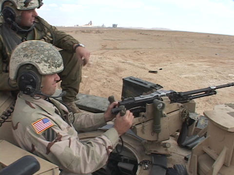 U.S. soldiers fire a machine gun from an Abrams tank Stock Video Footage