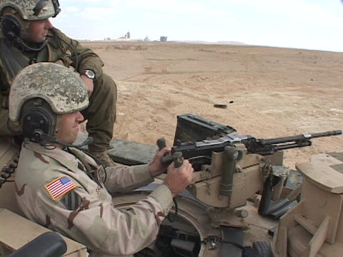 U.S. soldiers fire a machine gun from an Abrams tank Footage