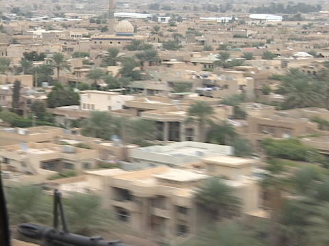 A Black hawk helicopter carrying soldiers flies over Baghdad Stock Video Footage