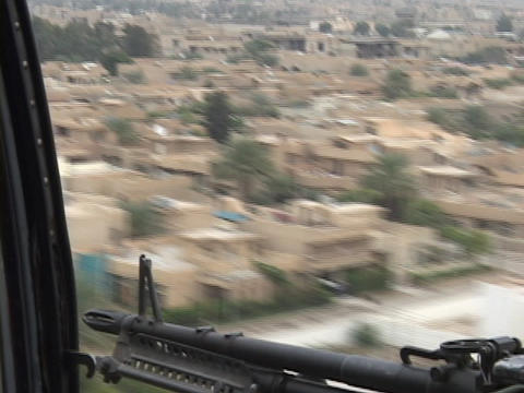 A Black hawk helicopter carrying soldiers flies over Baghdad Footage