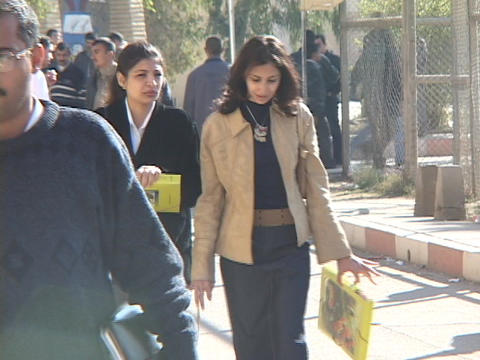 Students walk through the campus at Baghdad University Stock Video Footage