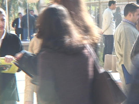 Students walk through the campus at Baghdad University Footage