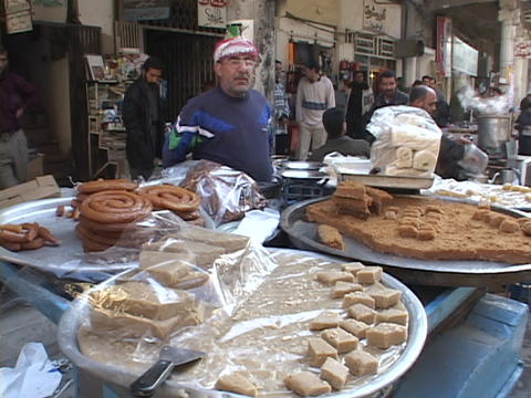 A street vendor sells food in Baghdad Stock Video Footage