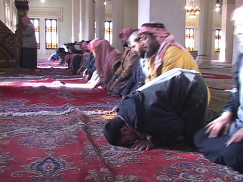 A group of Muslim men pray in a mosque in Baghdad Stock Video Footage