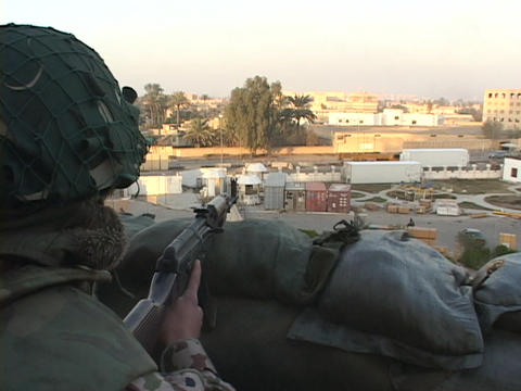 A soldier keeps guard over war-torn Baghdad, Iraq Stock Video Footage
