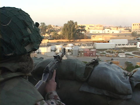 A soldier keeps guard over war-torn Baghdad, Iraq Footage