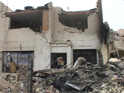 A building in Baghdad, Iraq stands nearly destroyed by... Stock Video Footage